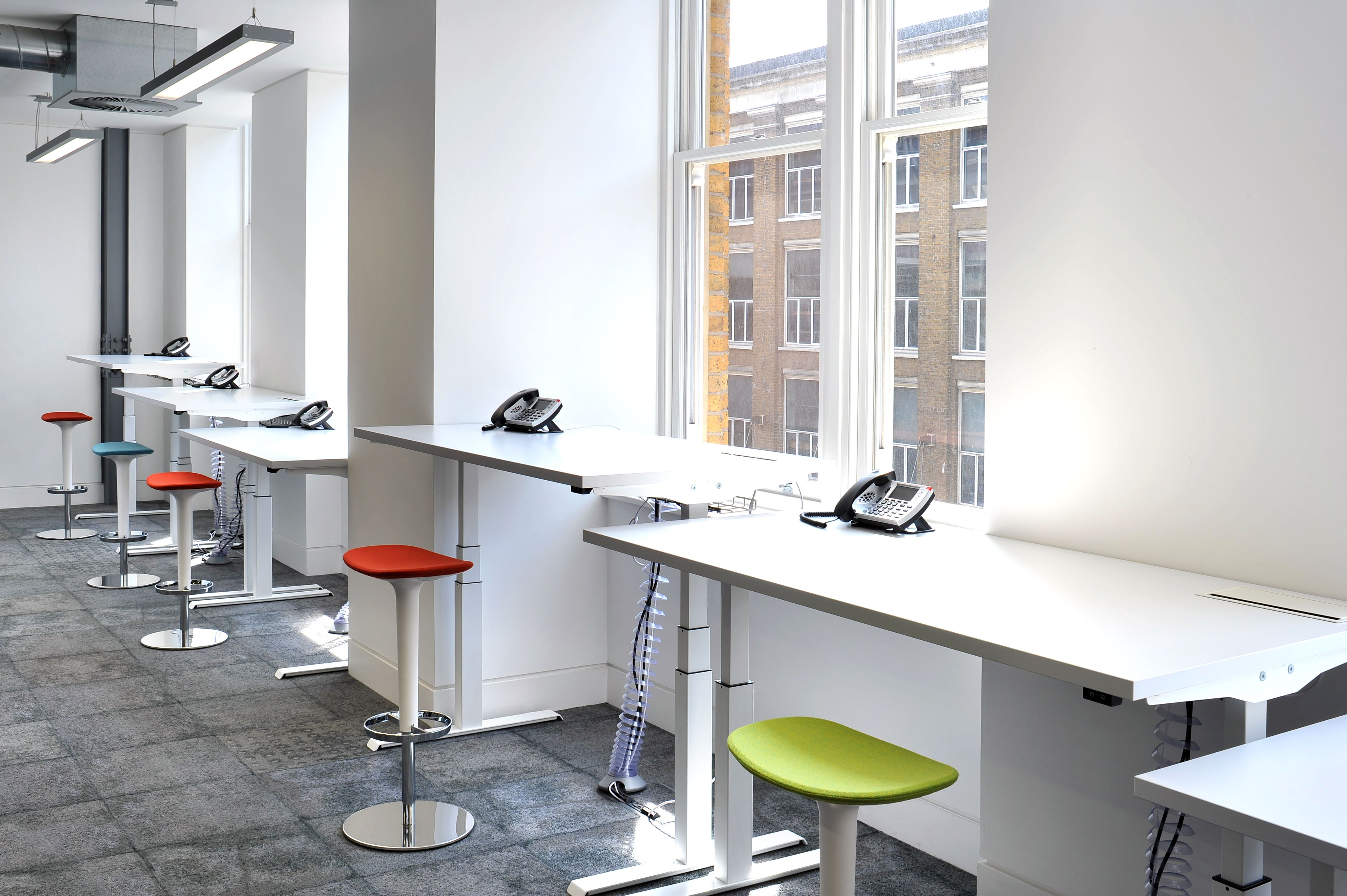 Hot Desk Area At Yammer In London Featuring Milliken S Comfortable Concrete And Fix Collections