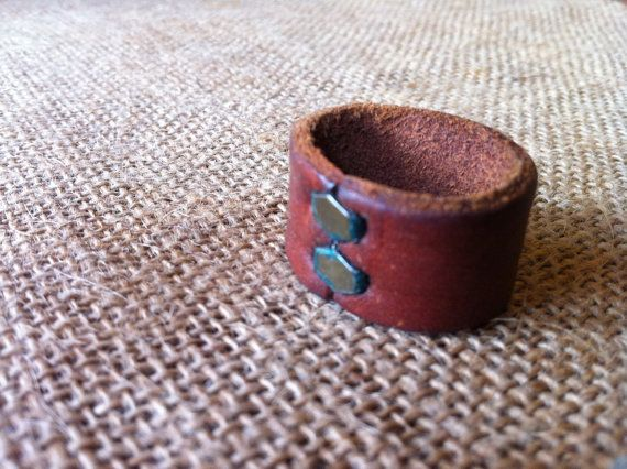 Vintage Men's Leather Ring with Metal clamps. $21.00, via Etsy.