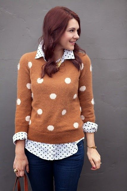 Polka dots white shirt with polka dots brown warm sweater and brown hand bag and dark blue casual jeans th perfect fashion