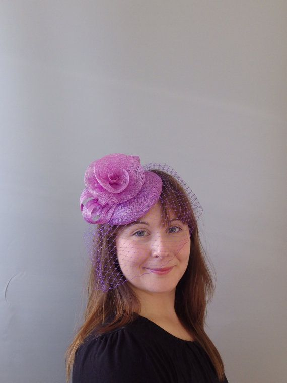 Fascinator set on an... Black hessian hatinator with loops and feather tendrils