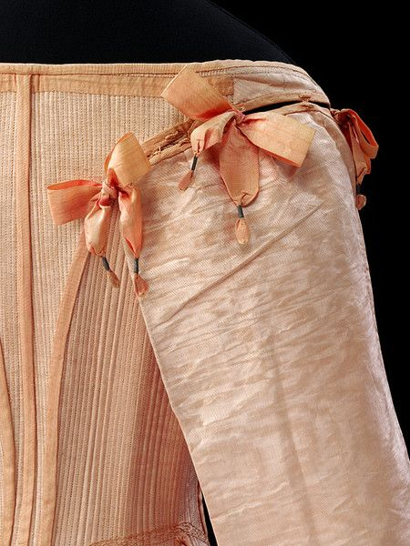 Stays and busk  Place of origin: England, Great Britain (probably, made)  Date: 1660-1670 (made)  Materials and Techniques: Pink watered silk (English or Italian), backed with linen, stitched with pink silk thread and reinforced with whalebone.