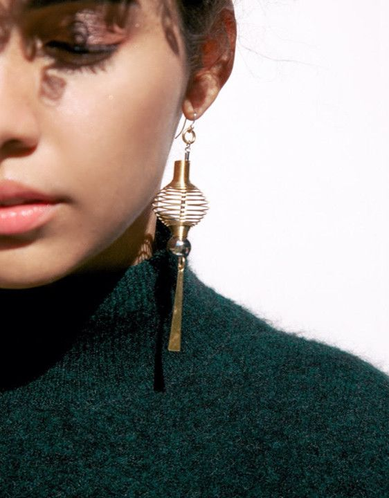 Let these 22k gold-plated statement earrings light your way bold, fearless style. –22k gold-plated w/ rhodium detail – Handmade in Canada