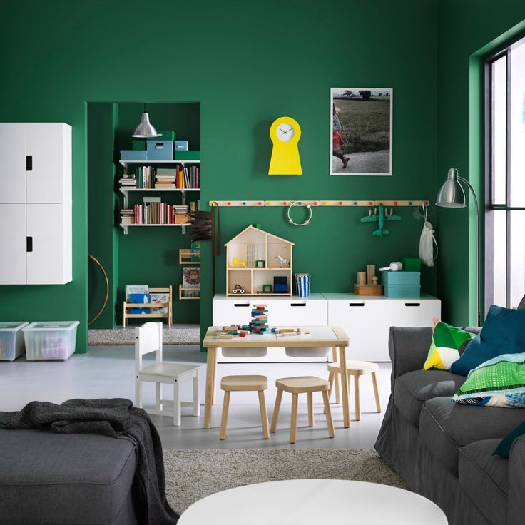 a playroom for children in the living room  toy storage