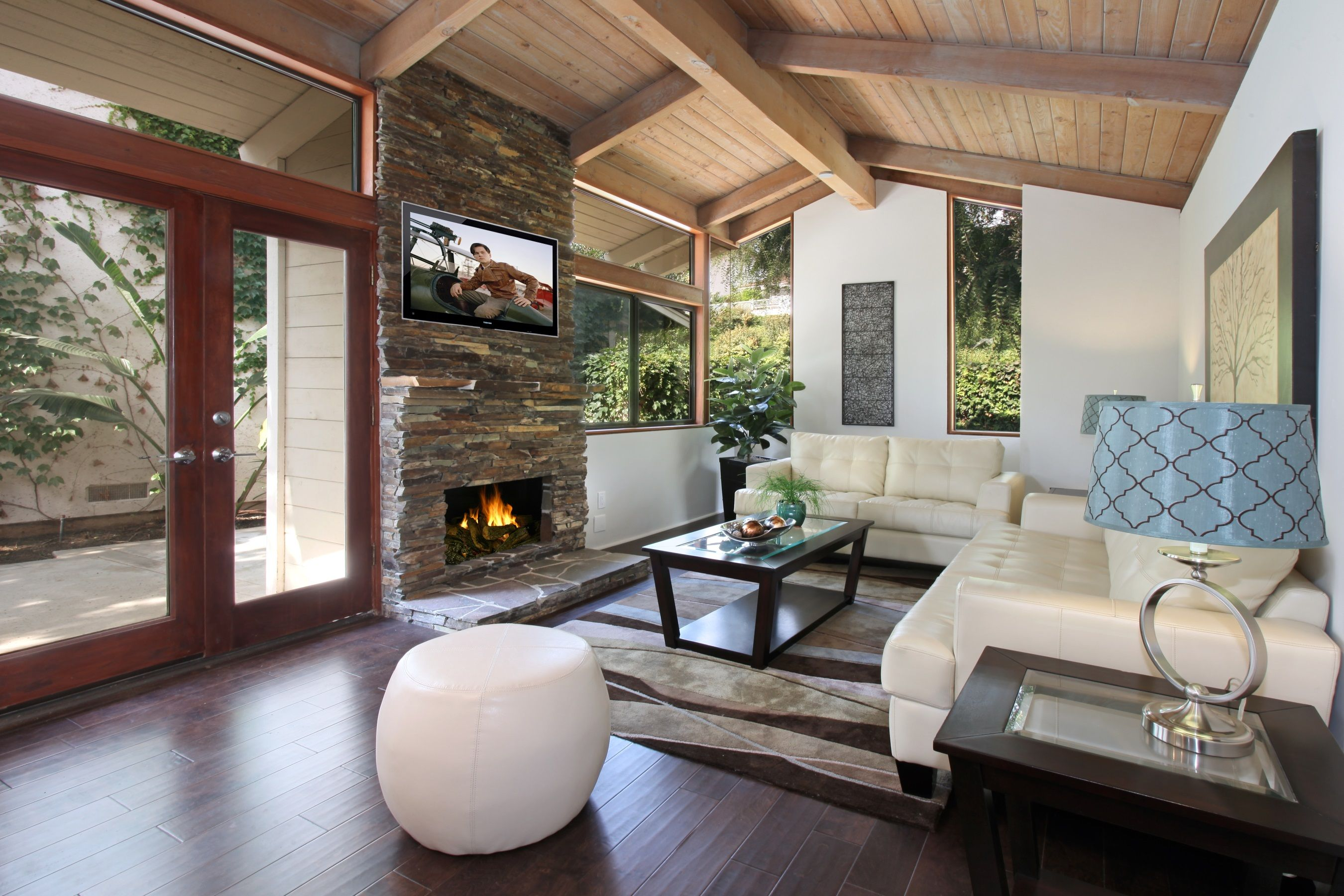 High vaulted ceilings and stacked stone fireplace. Love ...