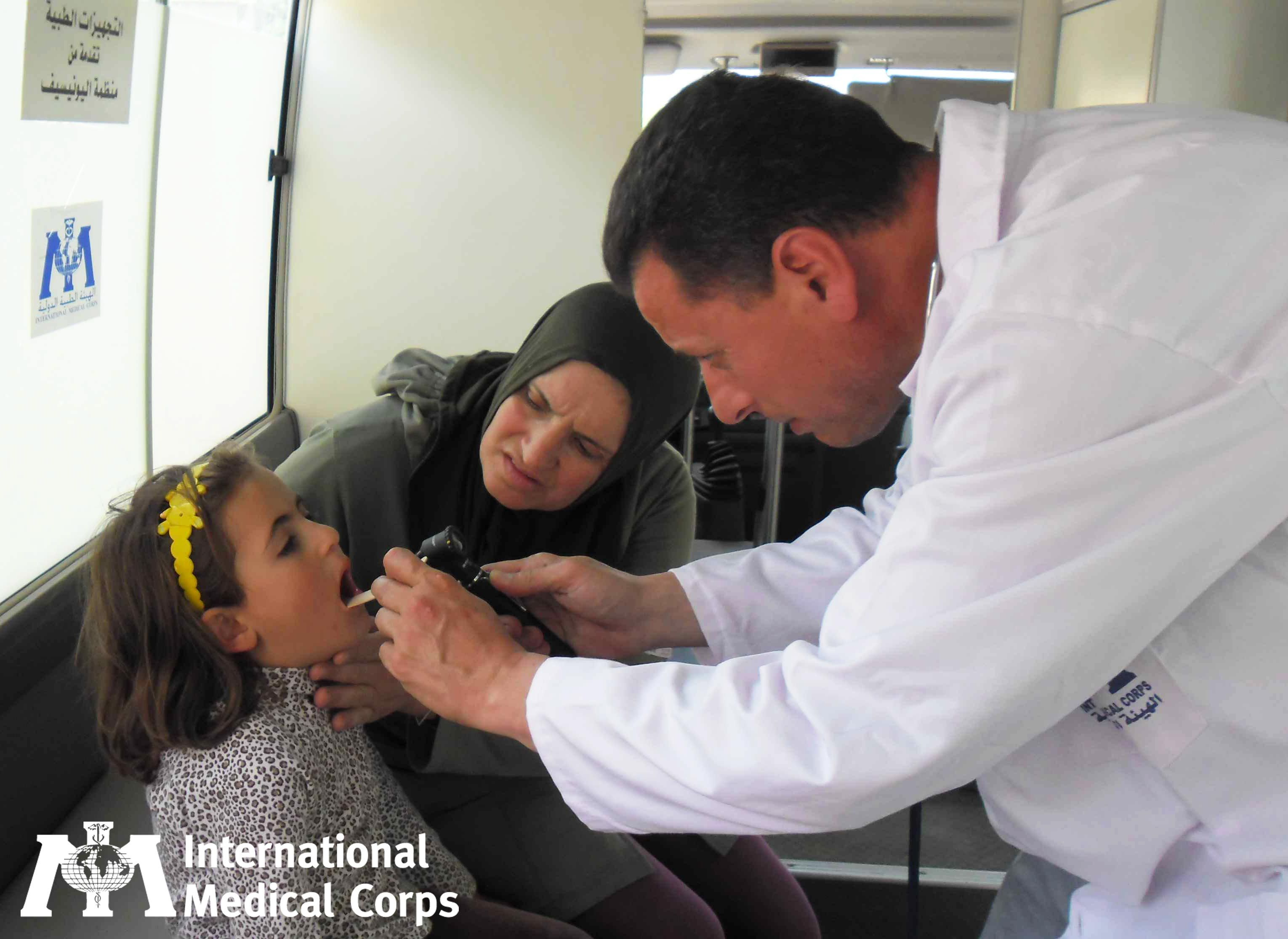 January 3:  Getting a checkup at a mobile medical unit in Lebanon.  Photo: International Medical Corps Staff, Lebanon 2012