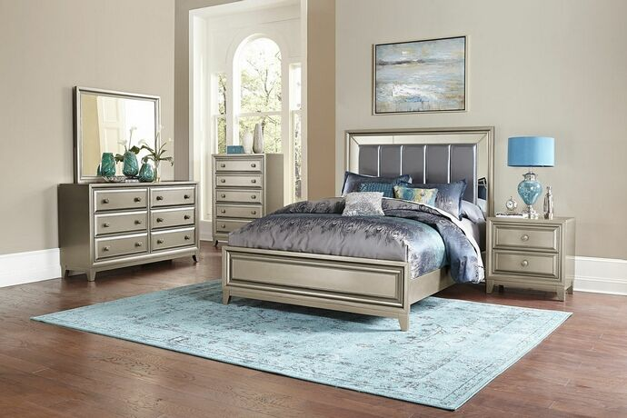"5 pc Hedy collection antique silver finish wood and graphite grey padded headboard bedroom set. This set includes the Bed, Nightstand, Dresser, Mirror and Chest. Bed measures 60"" H HB 19"" H FB. Nightstand measures 27"" x 17"" x 27"" H. Dresser measures 64"" x 18"" x 38"" H. Mirror measures 44"" x 1"" x 37"" H. Chest measures 38"" x 17"" x 52"" H..."
