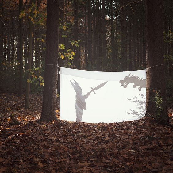 Outdoor shadow play with a sheet and light source. Combines nature with dramatic play/storytelling (verbal literacy) + movement (motor skills) + prop-making (process art).