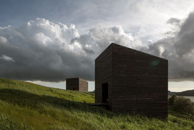 Modern Architecture New Zealand cheshire architects embeds monolithic eyrie cabins into rural new