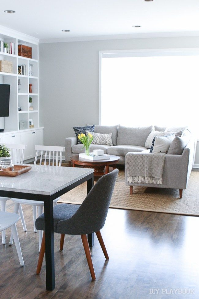A Gray Sectional In This Living Room E Sleek Couch Is The Perfect Decor Idea For City Home Like One Love Paint Color