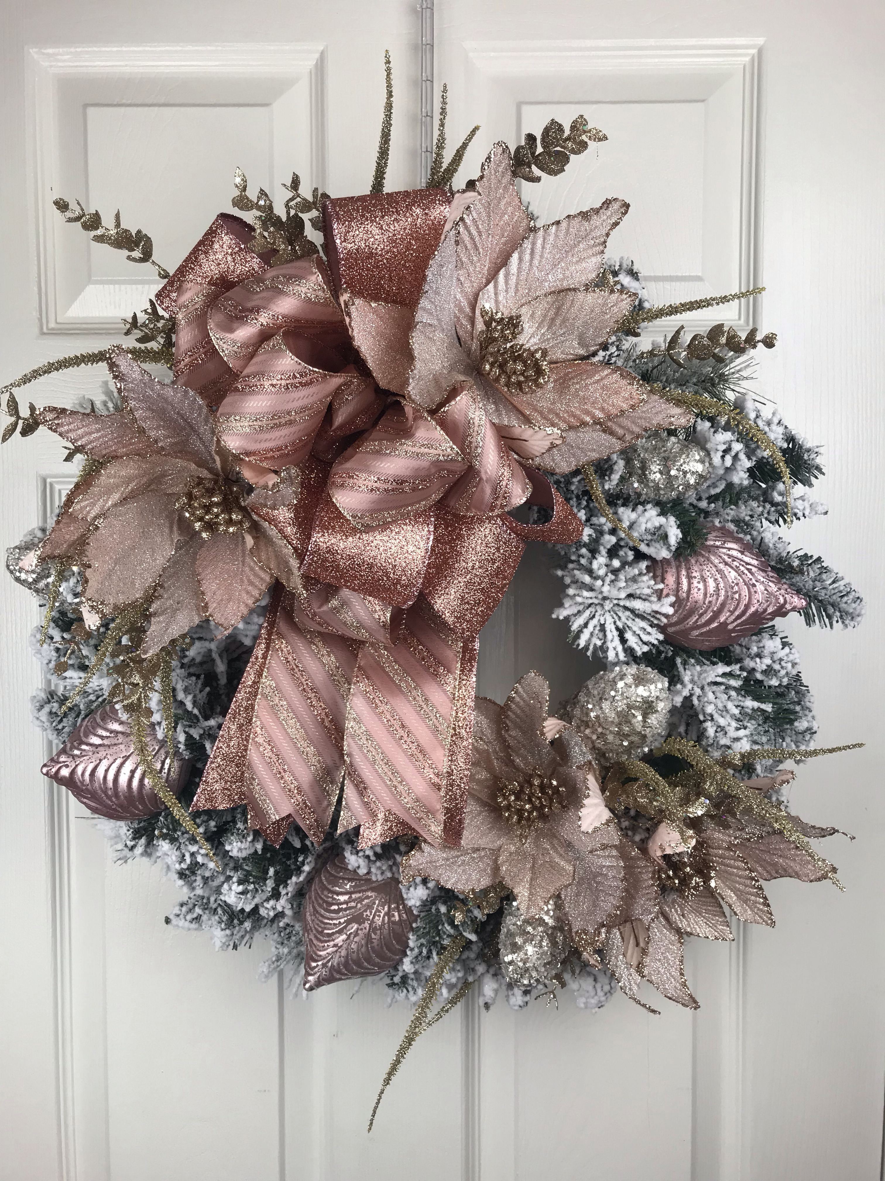 This elegant rose gold Christmas wreath will look amazing