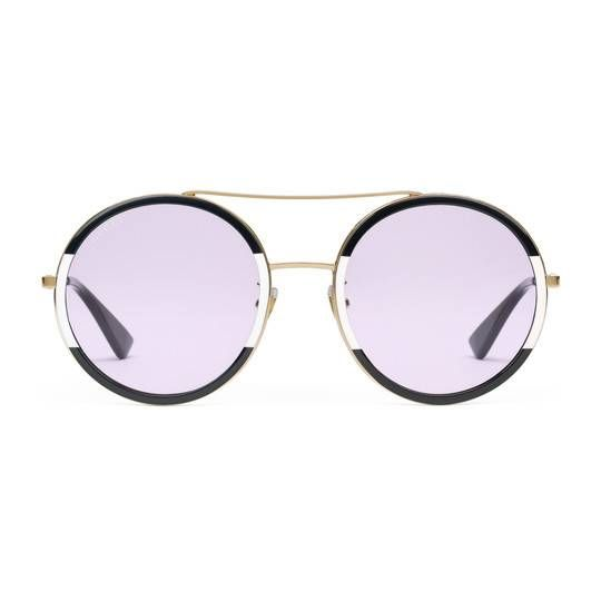5fae45e6e86  ad Click to Shop for Gucci Round-frame metal sunglasses   Ultra stylish  sunglasses with lavender lenses and black and ivory rims with gold accents.