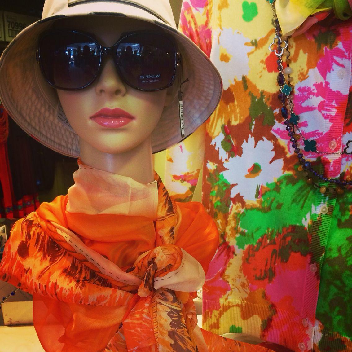 Closetconnoisseurresale.com  Spring fashion. Burberry rain hat. Jackie O. sunglasses