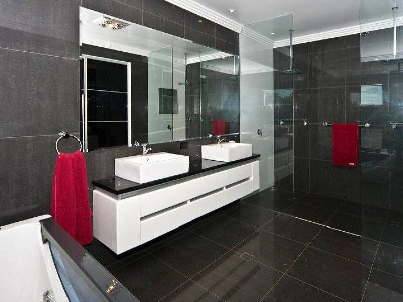 photo of a modern bathroom design with built in shelving using frameless glass from the bathroom galleries bathroom photo browse hundreds of images of