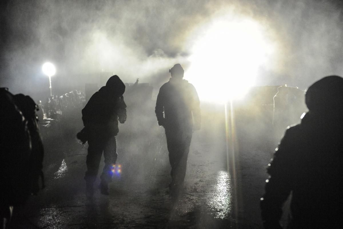 Police Tear Gas Protesters During A Protest Against Plans To Pass The Dakota Access Pipeline Near The Standing Rock Indian Res Standing Rock Cool Costumes Rock