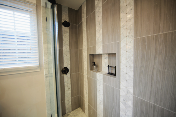 Check out the attention to detail on this tile shower. #DreamBuilders