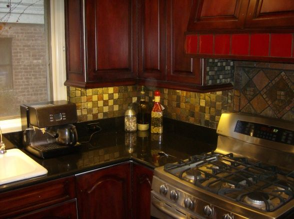 red mahogany kitchen cabinets kitchens with black countertops walls 25189