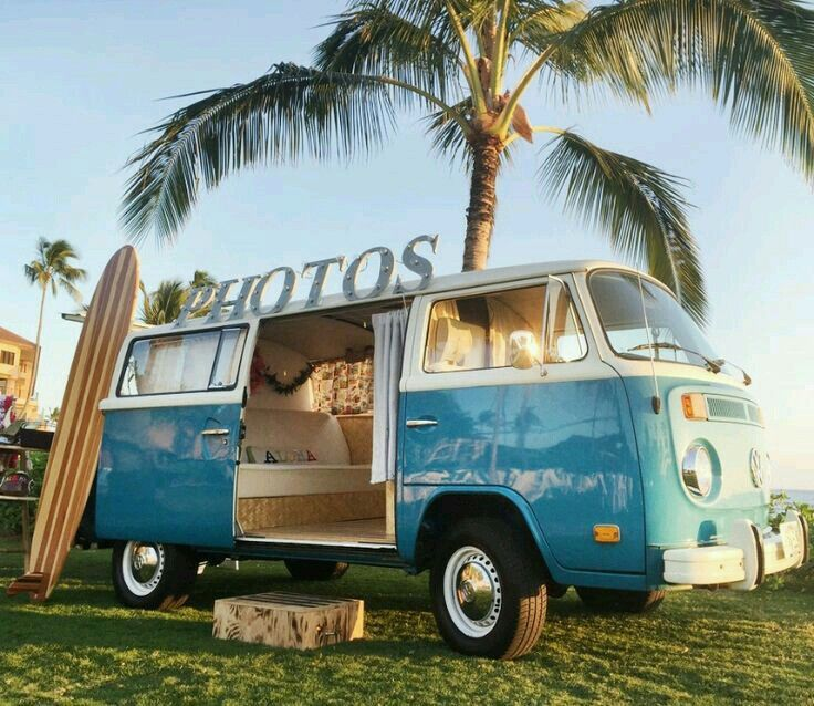 Perfect combination for a vw wedding event. Palm tree, surf  board, beach and a photo booth session in a vw bus