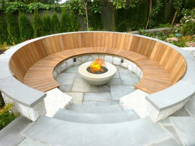 Photo of fireplace-garden-seat-round-seat-curved-wood-concrete-natural-stone-outd …