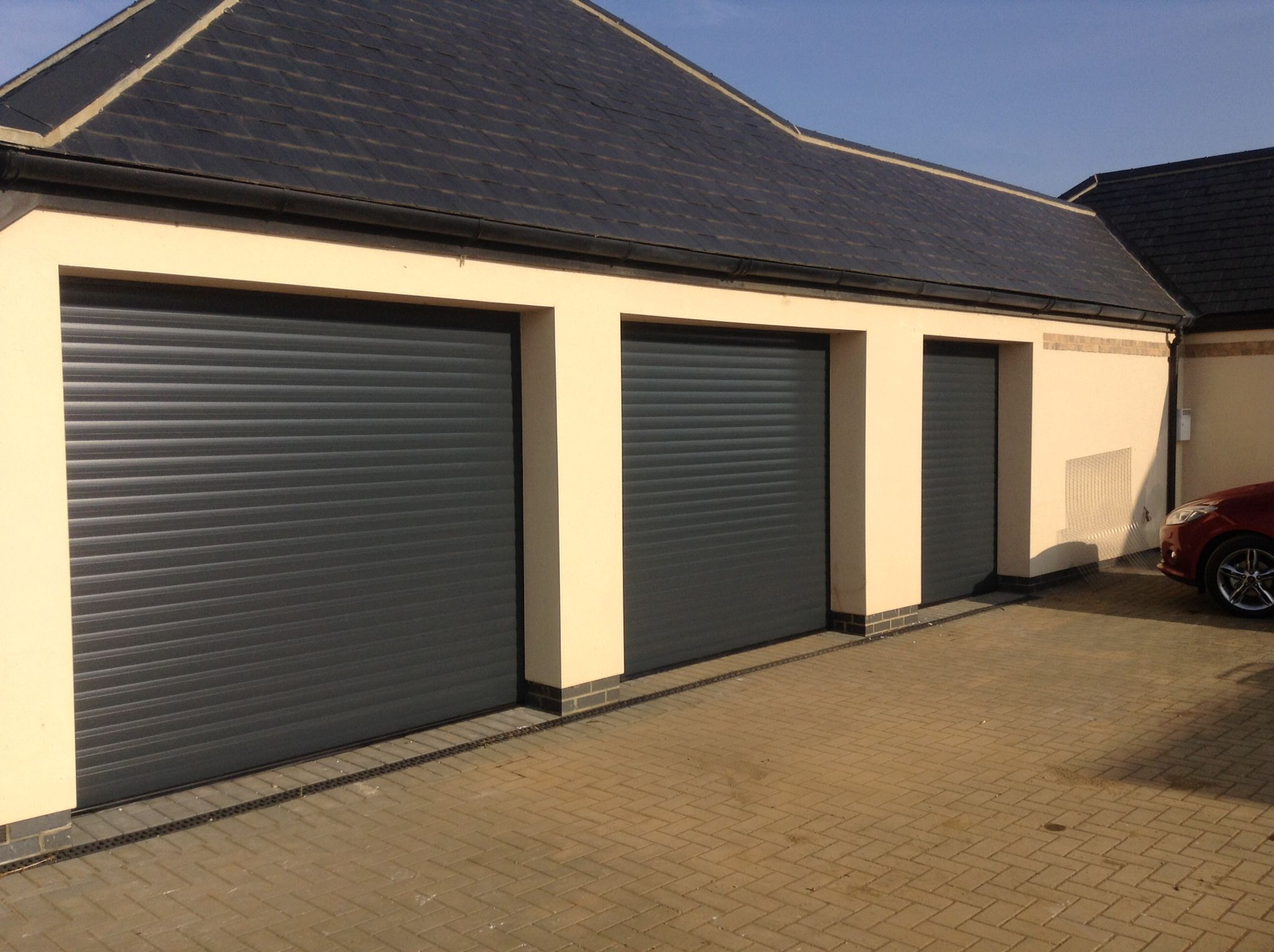 Seceuroglide insulated sectional garage door georgian cassette - Anthracite Grey Roller Doors Installed In Cambridgeshire