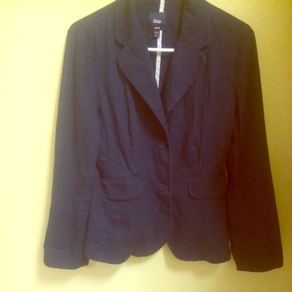Gap Navy Blue Blazer Gap size 4 navy blue blazer with a white and pink pinstriped lining that can be she on when the sleeves are folded up for a cute alteration. Two flap pockets in front, two navy blue button closures, collared, long sleeves, and 4 navy blue buttons at each sleeve end. GAP Jackets & Coats Blazers