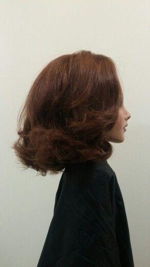 Barrel curls brushed side.
