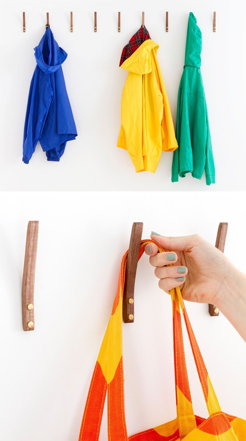 11 Creative Coat Hooks To Keep Your Clothes And Bags Off The Floor // This simple steam bent wooden hook adds a touch of warmth to your walls and they're strong enough to hang jackets, backpacks, shirts and scarves.