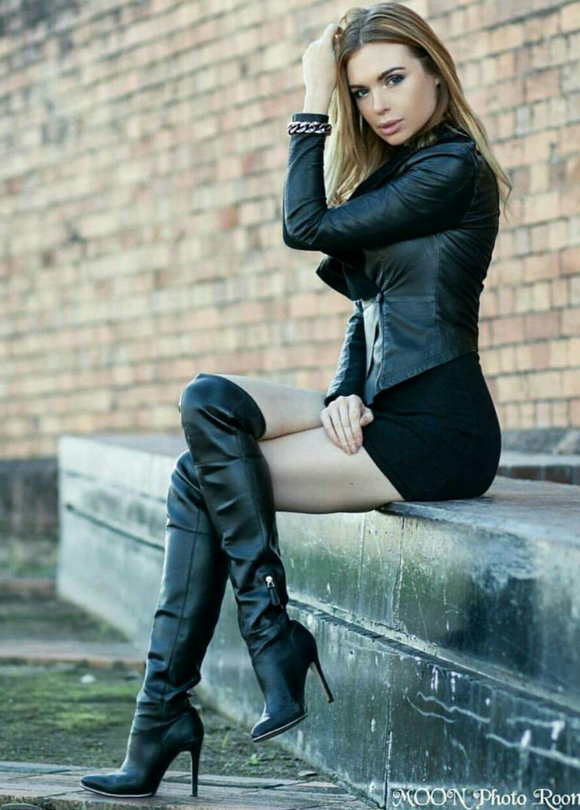 e346734fc7bf14 Beautiful girl modeling black leather jacket, bracelet, OTK boots ...