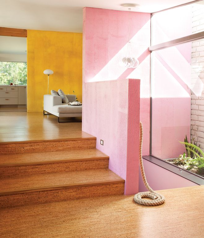 Cozy cork flooring neutralizes the bright colors of the walls in ...