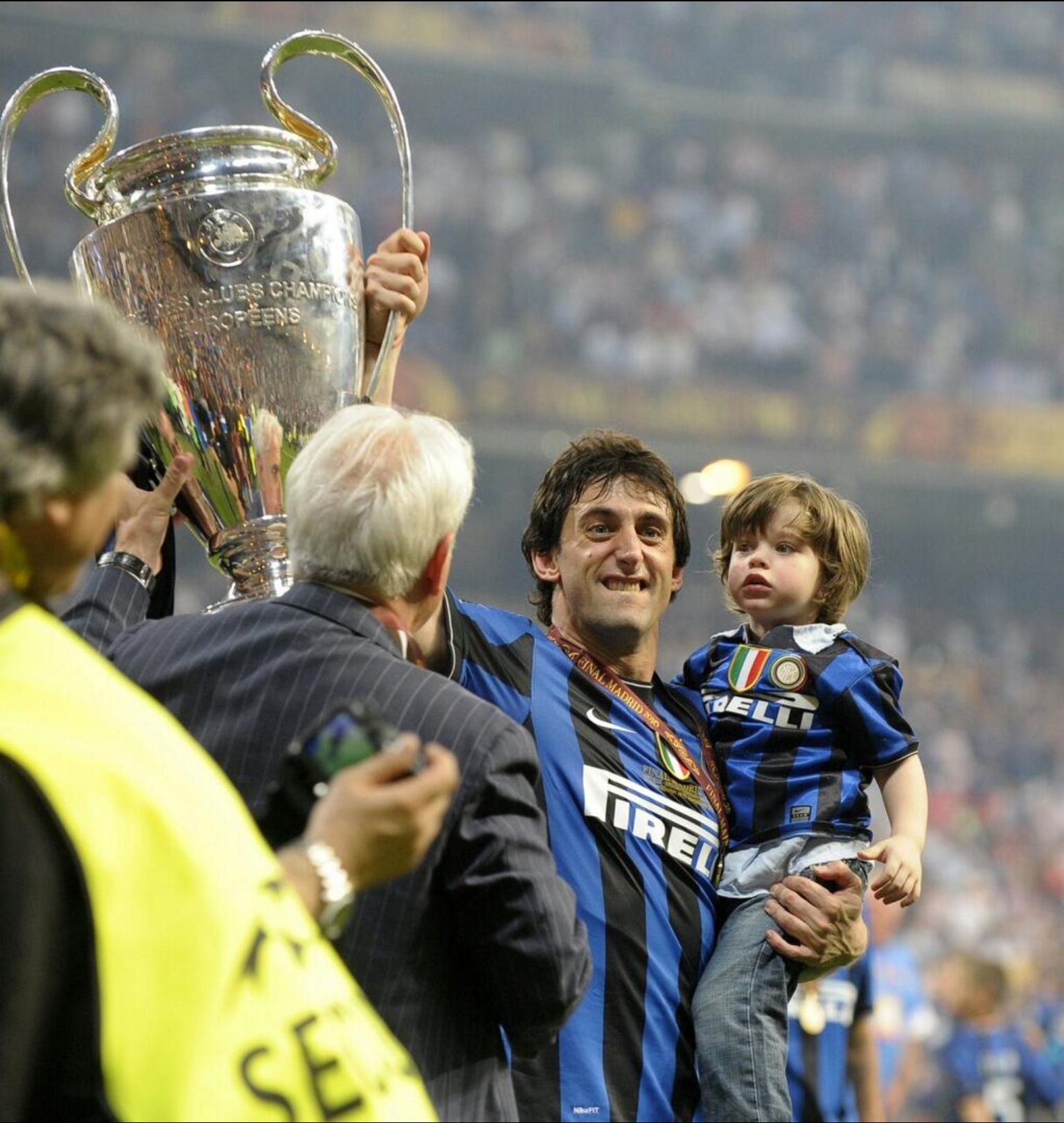 Milito and son