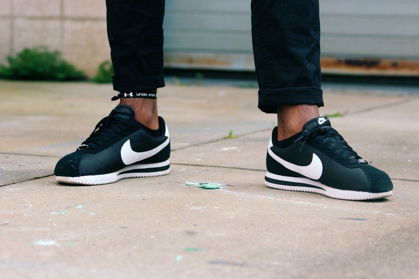 white Nike Cortez lace up sneakers