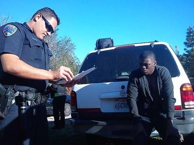 Rialto police officers serve an injunction notice to members of a ...