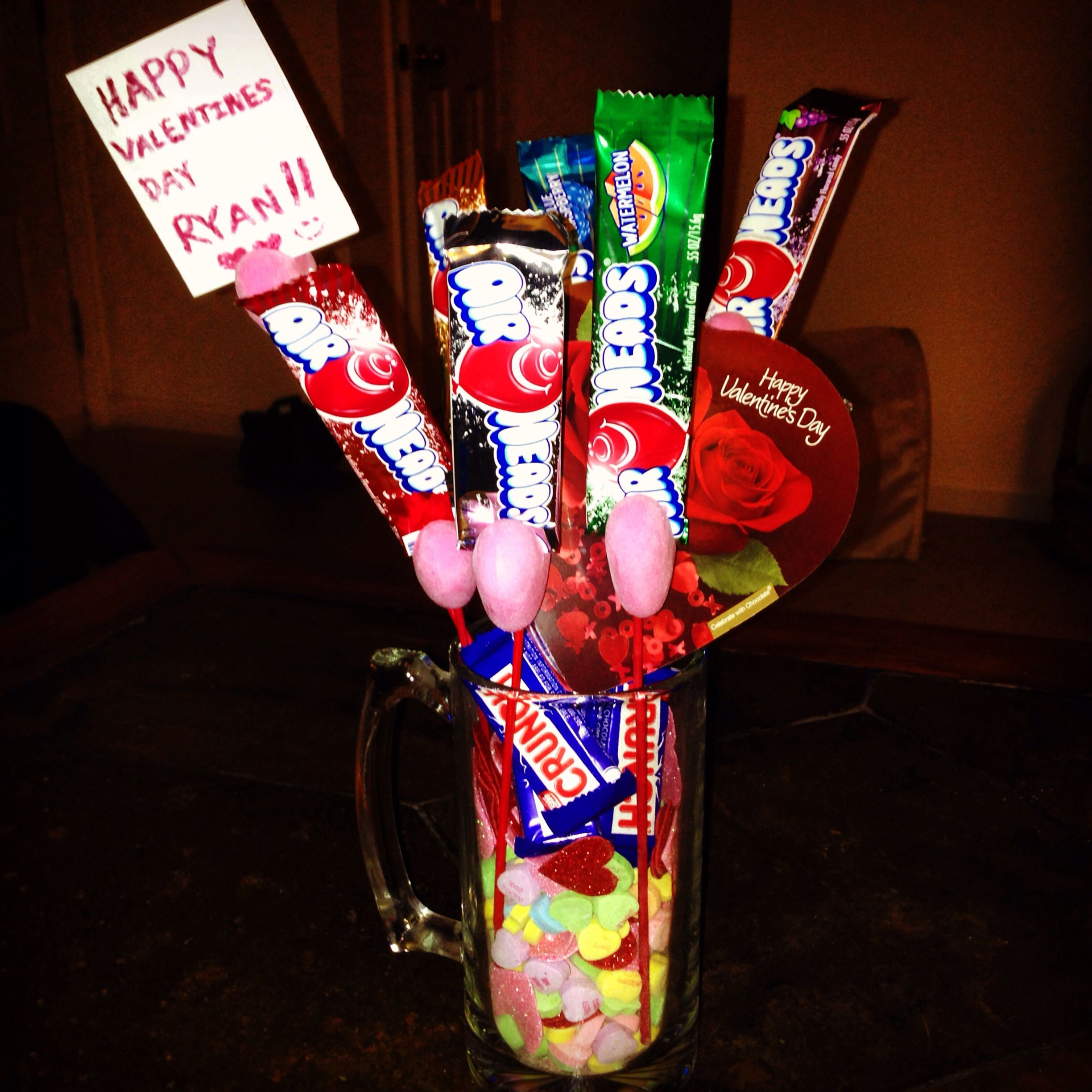 Candy bouquet idea for my boyfriend since he doesn't like flowers!! Super easy to make and all the stuff came from the filler store! And the mug can even be used after valentines day too!!