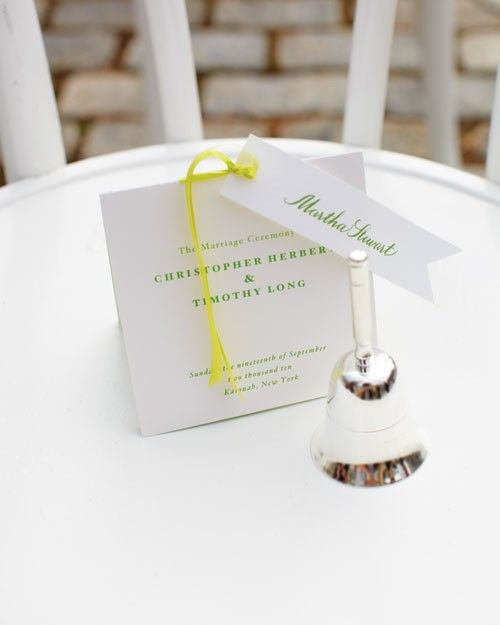 This couple chose a pretty green font for their personalized ceremony programs and tied the pieces together with a yellow ribbon.