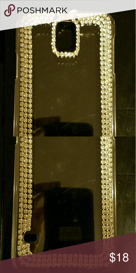 Galaxy 6 Phone Case Clear plastic case. Outlined with three rows of beautifully clear crystal colored rhinestones. Two larger rhinestones at the top resembling leafs.  New, mint condition.  Never used. Accessories Phone Cases