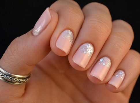 Baby pink nails with silver glitter.