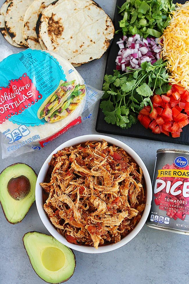 Instant Pot Chicken Tacos Make A Great Weeknight Meal. They Are Easy To Make And A Family Favorite! Load These Easy Shredded Chicken Tacos Up With All Of Your Favorite Mexican Toppings And Dinner Is Done! #chicken #tacos #chickentacos #InstantPot #easyrecipe #dinner #easydinner #tacotuesday #kidfriendly #shreddedchickentacos