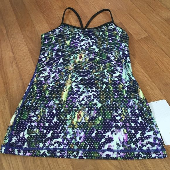 Lululemon power Y tank Love this print. It's a floral print with purples, greens & yellows with tiny white polka dots all over. The inside and straps are a coordinating olive green color. Bra cups are included. lululemon athletica Tops Tank Tops