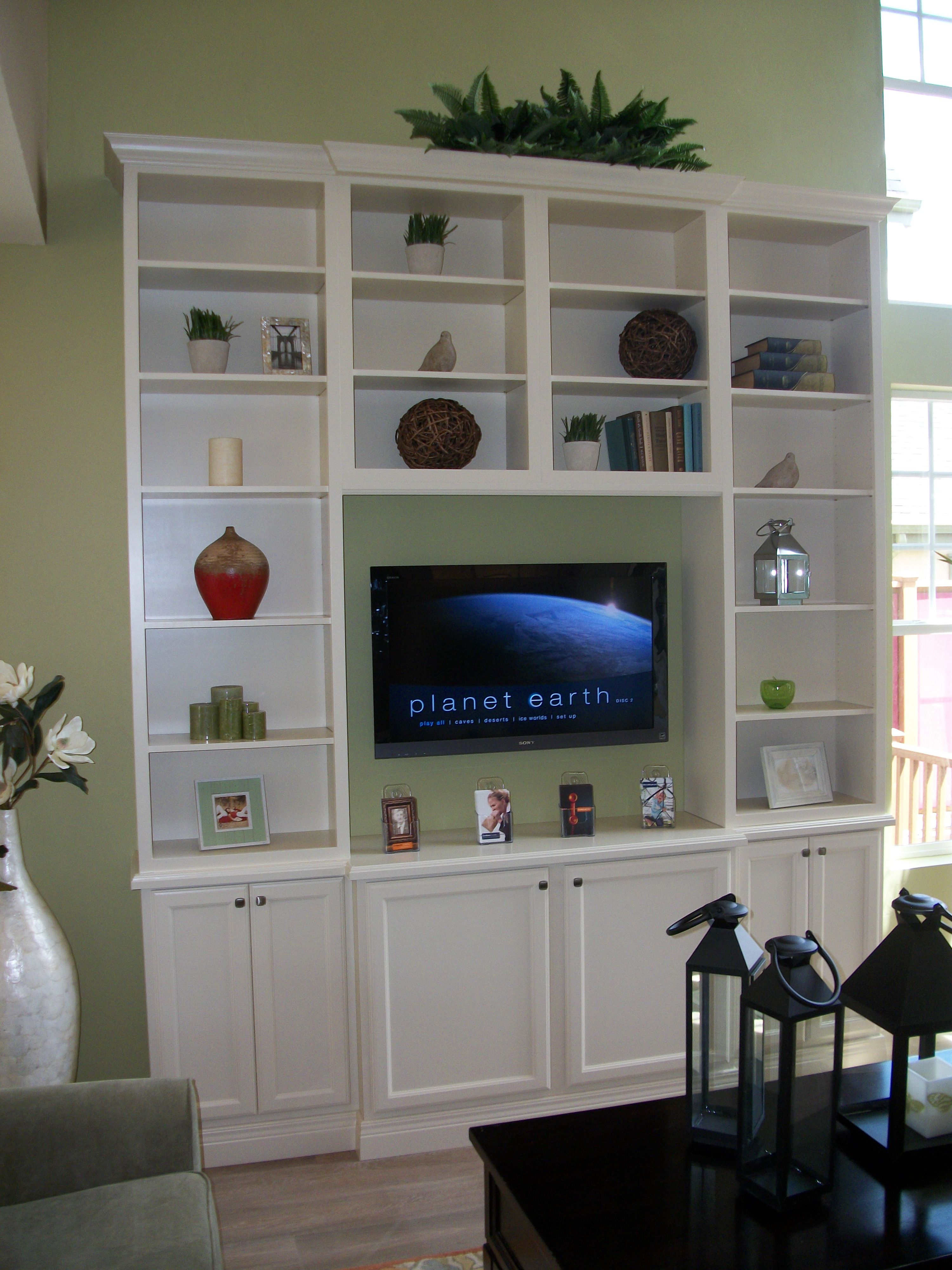DIY tall entertainment center with stock cabinets and