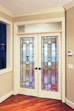 Beautiful Stained Glass Designs For Above Internal Double Doors
