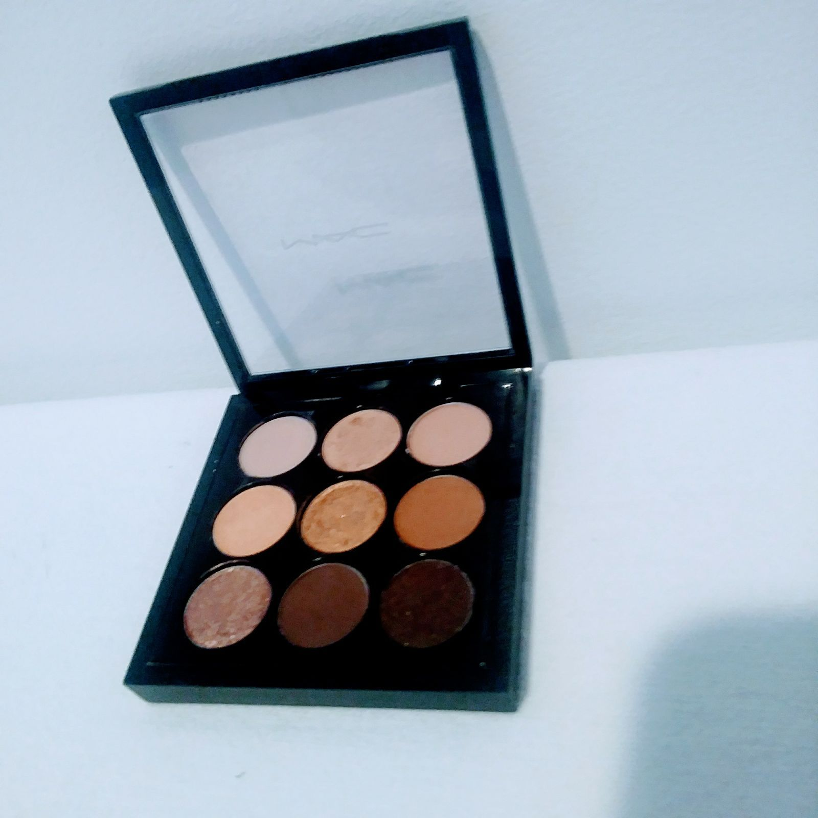 I purchase this palette new from mac cosmetic com and a