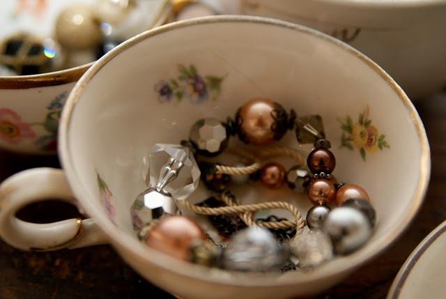 jewelry in an old coffee cup