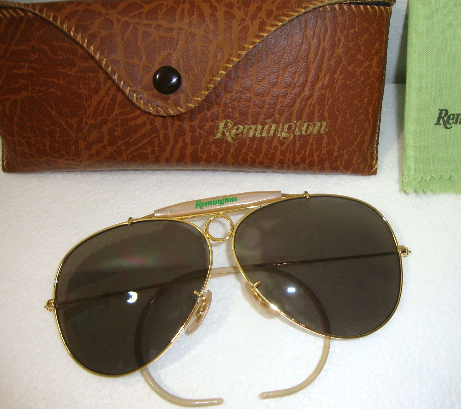 425f9f2b9d Vtg Remington Bullet Hole Gold Rim Aviator Sunglasses Shooting Glasses w  Case