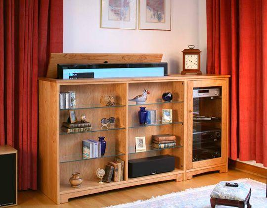 flatscreen tv hidden on an automatic lift hides inside the cabinet when you