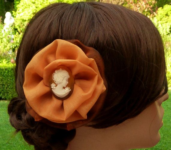 This elegant hair bloom in orange brown is a beautiful updo accessorie. The flower is fully and elaborately handcrafted from organza fabric in brown and orange cotton fabri... #etsy #jewelry #hairjewelry #necklace #earrings #craftoriteam