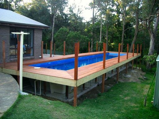Rectangular above ground pools with wooden decks country for Square above ground pool