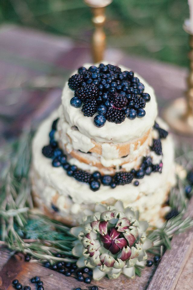 This naked cake with wild blueberries looks delightful!