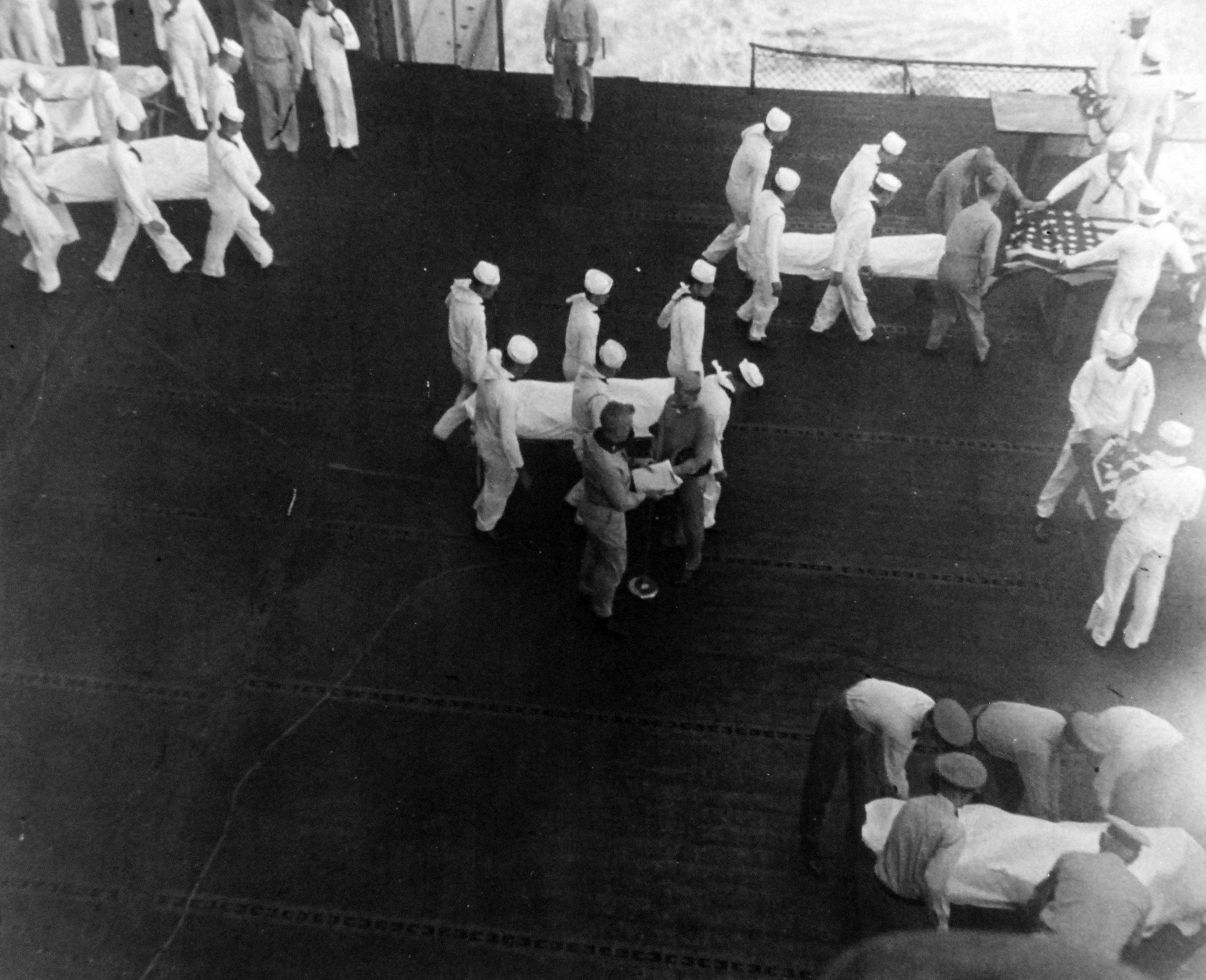 Navy casualties from a kamikaze attack on an Essex-class carrier are buried at sea in a moving ceremony. Released June 28, 1945. Official U.S. Navy photograph, now in the collections of the National Archives.