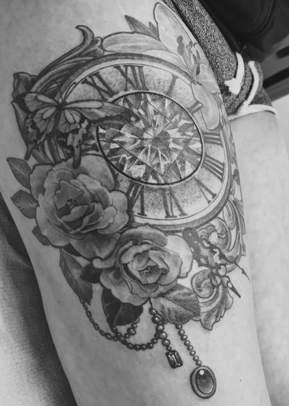 Still sitting in the tattoo parlour waiting to get wrapped up. That's why it looks so rough & raw, especially around the numbers. She's complete! #tattoo #tattoosforwomen #clocktattoo #butterflytattoo #roses #lily #fresh #flowertattoo #legtattoos