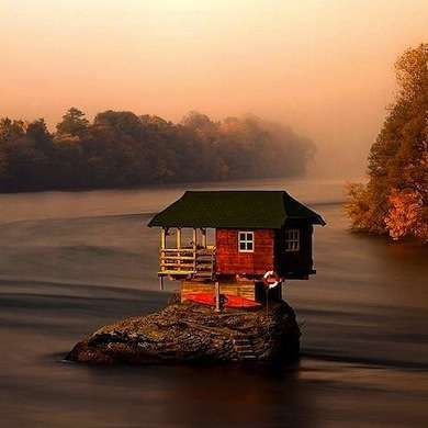 Built on a rocky island in the Drina River, near the town of Bajina Basta, Serbia, this wooden house was cobbled together by a group of boys in 1968 as a clubhouse for sunbathing and recreation. The house, which comprises one room and a covered porch, is now owned by the Bajina Basta Kayak Club.