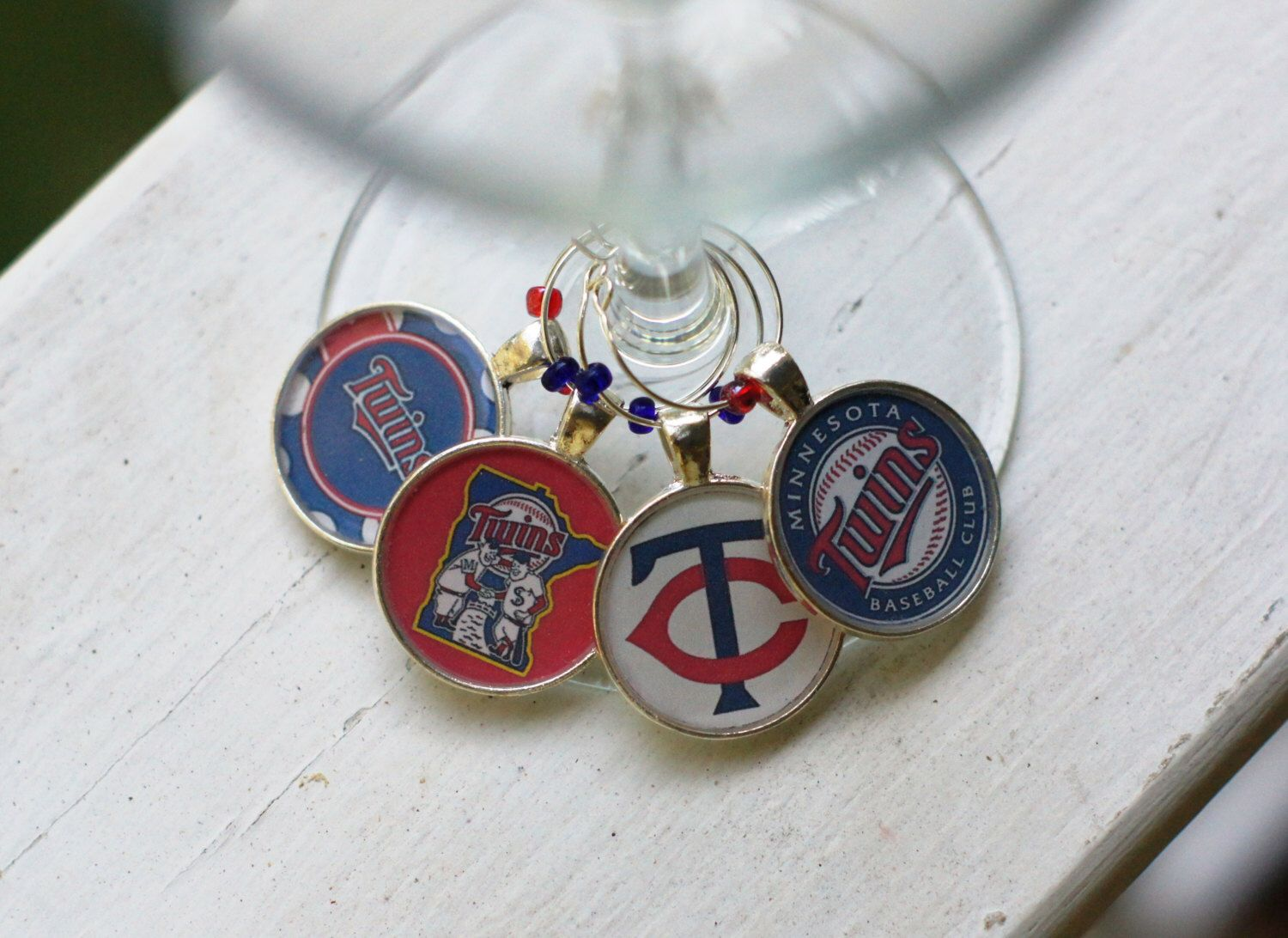A personal favorite from my Etsy shop https://www.etsy.com/listing/240724390/minnesota-twins-silver-wine-charms-set